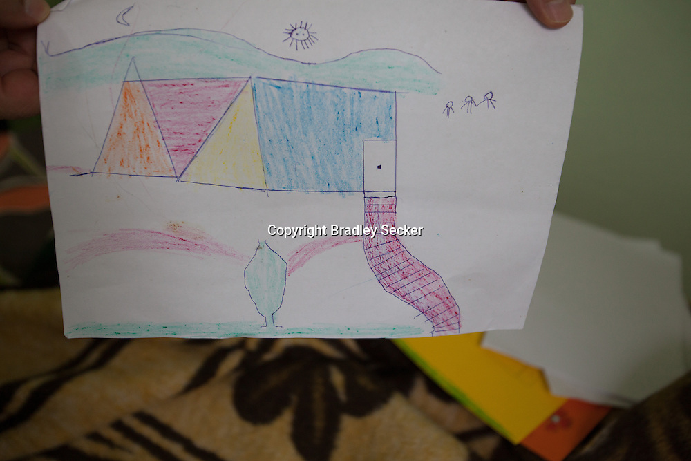 A young paraplegic patient made a drawing of his house in Syria, from his bed in a rehabalitation centre in the Turkish border town of Reyhanli. 04/01/2013