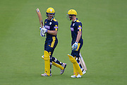 Jimmy Adams and Tom Alsop of Hampshire walk out to open the innings during the Royal London One Day Cup match between Hampshire County Cricket Club and Somerset County Cricket Club at the Ageas Bowl, Southampton, United Kingdom on 2 August 2016. Photo by David Vokes.