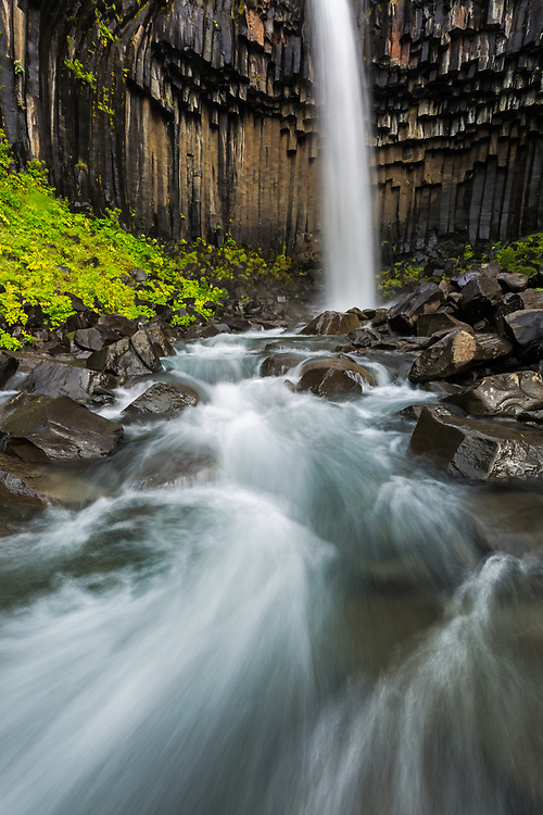 a wide angle landscape shot of Svartifoss waterfall in southeastern Iceland