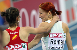 Second placed Natalia Rodriguez of Spain and Third placed Sonja Roman of Slovenia after the final race of 1500m women at the 2nd day of  European Athletics Indoor Championships Torino 2009 (6th - 8th March), at Oval Lingotto Stadium,  Torino, Italy, on March 6, 2009. (Photo by Vid Ponikvar / Sportida)