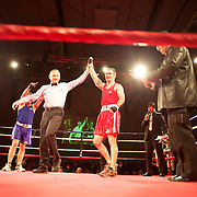 Brett Black (red) gets the points decision over Dave Hertog (blue) during their bout at the 'Thriller in the Chiller' charity boxing event as part of the Queenstown Winter Festival at the Queenstown Events Centre , South Island, New Zealand, 25th June 2011