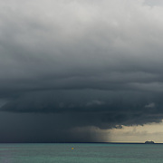 Cruise ship approaching storm in the caribbean. Riviera Maya. Quintana Roo, Mexico.