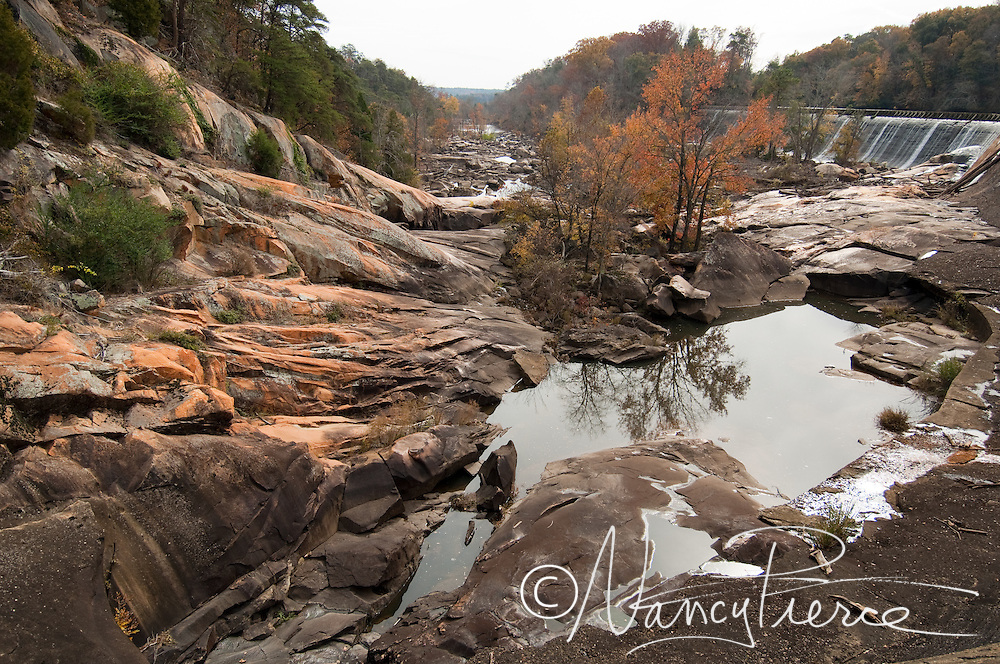 "This is the historical great falls of the Catawba River in Chester County, SC. In 1907 the river was diverted for hydro production to power cotton mills, and these rocks have been exposed as a ""dry bed"" ever since. In 2007 with Duke Energy's hydro relicensing process, Duke agreed to once again pass water through the dam over these rocks for whitewater paddling. The town of Great Falls, which has lost all three of its cotton mills, is economically depressed and hopes that outdoor recreation will some day be a boon to its economy."
