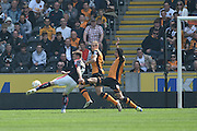 Rotherham United midfielder Lee Frecklington (8) scores to go 1-0 up  during the Sky Bet Championship match between Hull City and Rotherham United at the KC Stadium, Kingston upon Hull, England on 7 May 2016. Photo by Ian Lyall.