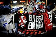 Frankfurt | 07 October 2016<br /> <br /> Am Freitag (07.10.2016) versammelten sich in Wetzlar etwa 80 Neonazis aus dem Umfeld der NPD, von neonazistischen Freien Kameradschaften, dem sog. Freien Netz Hessen und der Identit&auml;ren Bewegung zu einer Demonstration &quot;gegen &Uuml;berfremdung&quot;. Die geplante Demo-Route war von etwa 1600 Anti-Nazi-Aktivisten blockiert, daher wurde den Neonazis eine neue Demoroute durch Altstadt und Innenstadt von Wetzlar vorbei am Wetzlarer Dom zugewiesen. Auch hier stellten sich den Rechten immer wieder Aktivisten in den Weg.<br /> Hier: Aktivisten aus dem Umfeld der Neonazi-Netzwerks Freies Netz Hessen (FN Hessen) stehen vor Beginn der Demo auf einem Parkplatz am Bahnhof von Wetzlar und verstecken sich hinter Transparenten.<br /> <br /> photo &copy; peter-juelich.com<br /> <br /> FOTO HONORARPFLICHTIG, Sonderhonorar, bitte anfragen!