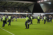 Police on the pitch after Millwall win during the The FA Cup fourth round match between Millwall and Everton at The Den, London, England on 26 January 2019.