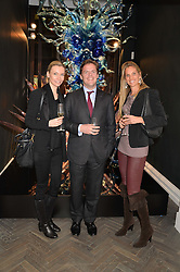 Left to right, JESSICA NEUBERT, ANTHONY GARTON and CHRISTINE SHEPPARD at a private view of work by artist Dale Chihuly: Beyond the Object was held at The Halcyon Gallery 144-146 New Bond Street, London on 5th February 2014.