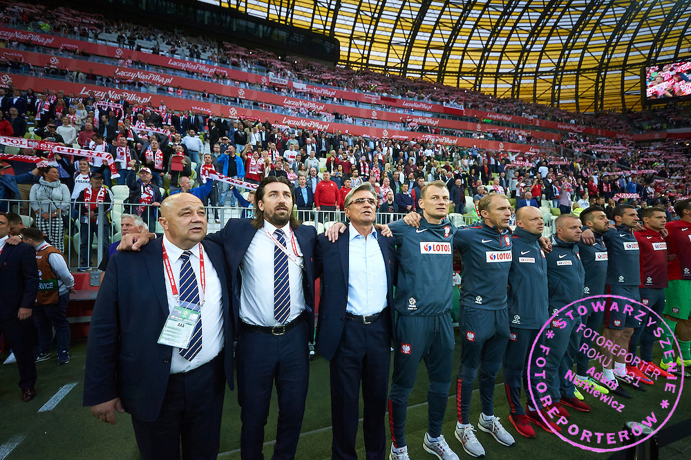 (2L) Tomasz Iwan and (3R) Adam Nawalka trainer coach of Poland stand while national anthem during international friendly soccer match between Poland and Greece at PGE Arena Stadium on June 16, 2015 in Gdansk, Poland.<br /> Poland, Gdansk, June 16, 2015<br /> <br /> Picture also available in RAW (NEF) or TIFF format on special request.<br /> <br /> For editorial use only. Any commercial or promotional use requires permission.<br /> <br /> Adam Nurkiewicz declares that he has no rights to the image of people at the photographs of his authorship.<br /> <br /> Mandatory credit:<br /> Photo by &copy; Adam Nurkiewicz / Mediasport