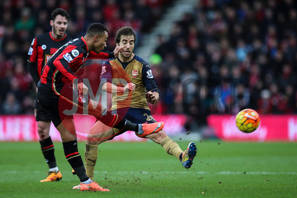 Junior Stanislas of Bournemouth under pressure from Mathieu Flamini of Arsenal - Mandatory by-line: Jason Brown/JMP - Mobile 07966 386802 07/02/2016 - SPORT - FOOTBALL - Bournemouth, Vitality Stadium - AFC Bournemouth v Arsenal - Barclays Premier League