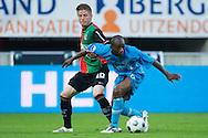 27-08-2011: Voetbal:NEC Nijmegen:Heracles Almelo:Niijmegen<br /> NEC's Lasse SCHÖNE in duel met Heracles Almelo's Kwame QUANSAH <br /> Foto: Geert van Erven