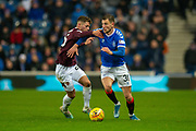 Borna Barisic (#31) of Rangers FC runs past Jamie Brandon (#25) of Heart of Midlothian FC during the Ladbrokes Scottish Premiership match between Rangers FC and Heart of Midlothian FC at Ibrox Park, Glasgow, Scotland on 1 December 2019.