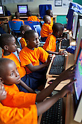 Children (K3, 5 - 6 years old) that attend the kindergarten school learn computer skills during lessons at the Wema Centre, Mombassa, Kenya.