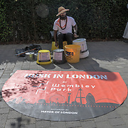 Musician performs at the International Busking Day is returning to Wembley Park on 20 July 2019, London, UK.