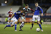 Matthew Taylor of Burnley battles with Lee Peltier and Tom Lawrence of Cardiff City during the Sky Bet Championship match between Burnley and Cardiff City at Turf Moor, Burnley, England on 5 April 2016. Photo by Simon Brady.