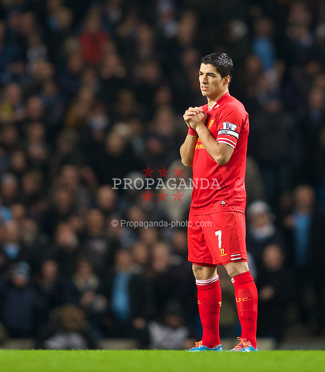 MANCHESTER, ENGLAND - Boxing Day Thursday, December 26, 2013: Liverpool's captain Luis Suarez prays before the Premiership match against Manchester City at the City of Manchester Stadium. (Pic by David Rawcliffe/Propaganda)