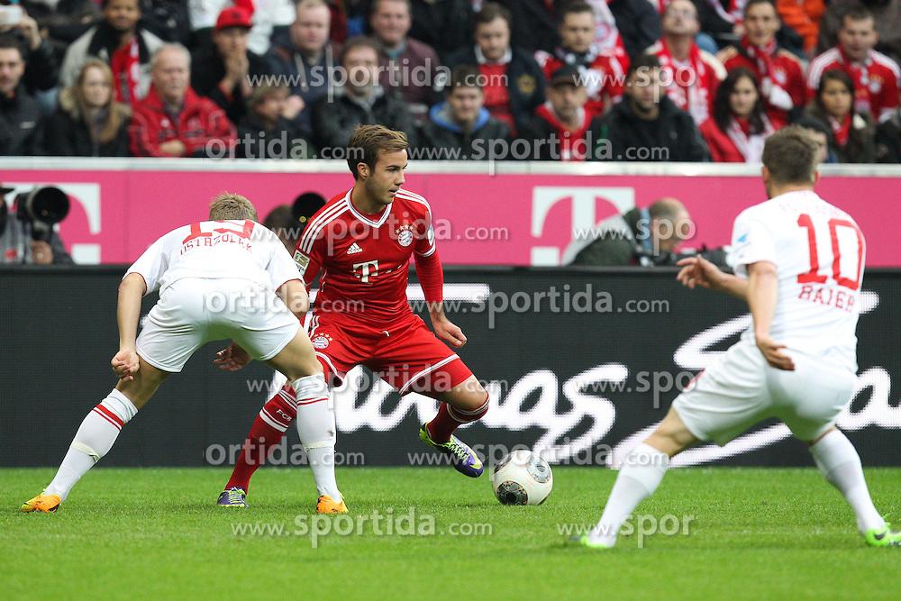 09.11.2013, Allianz Arena, Muenchen, GER, 1. FBL, FC Bayern Muenchen vs FC Augsburg, 12. Runde, im Bild l-r: im Zweikampf, Aktion, mit Jan-Ingwer CALLSEN-BRACKER #18 (FC Augsburg), Mario GOETZE #19 (FC Bayern Muenchen), Daniel BAIER #10 (FC Augsburg) // during the German Bundesliga 12th round match between FC Bayern Munich and FC Augsburg at the Allianz Arena in Muenchen, Germany on 2013/11/09. EXPA Pictures &copy; 2013, PhotoCredit: EXPA/ Eibner-Pressefoto/ Kolbert<br /> <br /> *****ATTENTION - OUT of GER*****