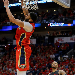 Apr 19, 2018; New Orleans, LA, USA; New Orleans Pelicans forward Anthony Davis (23) dunks over Portland Trail Blazers guard Damian Lillard (0) during the second quarter in game three of the first round of the 2018 NBA Playoffs at the Smoothie King Center. Mandatory Credit: Derick E. Hingle-USA TODAY Sports