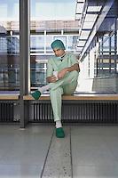 Pensive Physician having coffee in hospital corridor