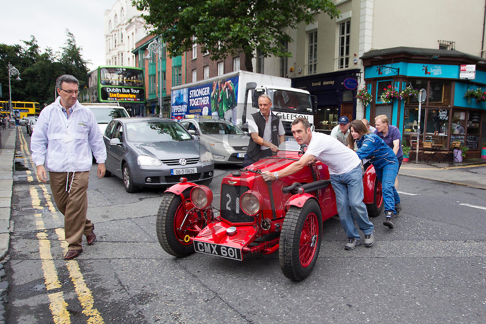 "Repro Free: 01/08/2013 James Foster from North Carolina in the United States is pictured in the winner of the 1936 Limerick Grand Prix a 1934 MG PB Supercharged, as some of the world's most expensive cars were on show today at the Mansion House in Dublin as they arrived in Ireland ahead of the Irish Festival of Speed this weekend in Limerick. The four cars; a 1936 ERA R10B worth in excess of €1.5million, a 1935 ERA R5B ""Remus"" worth in excess of €1.5million and a Aston Martin Works Ulster 1935 Team LM 21 worth €2million and owned by Pink Floyd's Nick Mason. are all en route to the Festival, which takes place on Saturday and Sunday the 3rd and 4th August at the Limerick Racecourse. Picture Andres Poveda"