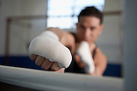 Man in fighting stance wearing wristbands close-up of hand