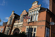 A Union Jack hangs from the exterior of The Surbiton Club, on 7th November 2019, Surbiton, London, England. The Surbiton Club is a friendly & relaxed members social club, in the heart of Surbiton in St James' Road.
