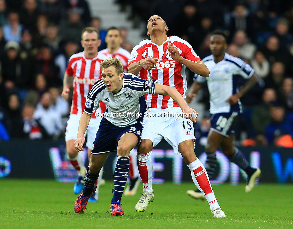 14th March 2015 - Barclays Premier League - West Bromwich Albion v Stoke City - Darren Fletcher of West Bromwich Albion falls as Steven Nzonzi of Stoke City watches the ball - Photo: Paul Roberts / Offside.