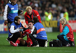 Georgia's Alexander Todua is attended to by medics in the Rugby World Cup pool match against England at Otago Stadium, Dunedin, New Zealand, Sunday, September 18, 2011. Credit:SNPA / Dianne Manson.