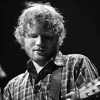 Musician Ed Sheeran performs on stage at the Amway Center on Tuesday, September 8, 2015 in Orlando, Florida. This images was captured in a black and white format.  (Alex Menendez via AP)