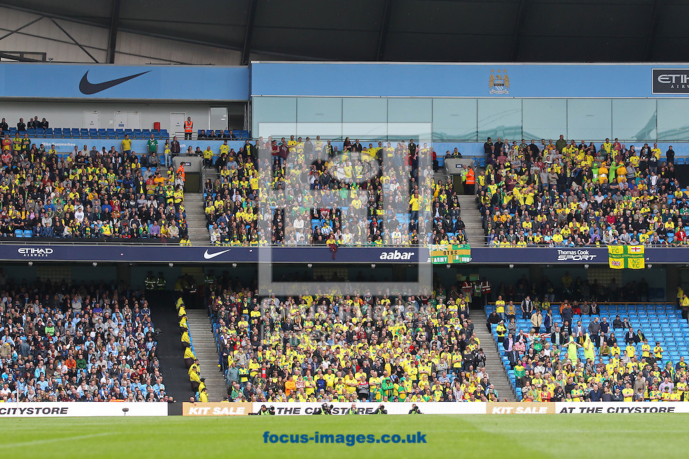 Picture by Paul Chesterton/Focus Images Ltd +44 7904 640267.Norwich fans during the Barclays Premier League match at The Etihad Stadium, Manchester.