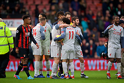 BOURNEMOUTH, ENGLAND - Saturday, December 8, 2018: Liverpool's hat-trick hero Mohamed Salah, with the match ball, is congratulated by team-mate James Milner after the 4-0 victory over AFC Bournemouth during the FA Premier League match between AFC Bournemouth and Liverpool FC at the Vitality Stadium. (Pic by David Rawcliffe/Propaganda)