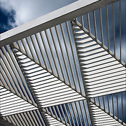 Looking up into AIDS Memorial 18-foot white canopy sculpture and sky.<br />
