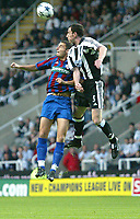 Photo. Andrew Unwin<br /> Newcastle v Partizan Belgrade, Champions League Third Qualifying Round, Second leg, St James' Park, Newcastle 27/08/2003.<br /> Newcastle's Alan O'Brian outjumps Partizan Belgrade's Andrija Delibasic.