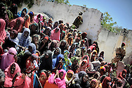 """Street images from the destroyed city of Mogadishu... woman at a rally selebrating the mayor of the city.Death or Play. Women´s Basketball in Mogadishu<br /> Women's basketball? In Europa and the U.S., we take it for granted. But consider this: In Mogadishu, war-torn capital of Somalia, young women risk their lives every time they show up to play.<br /> Suweys, the captain of the Somali women´s basketball team, and her friends play the sport of the deadly enemy, called America. This is why they are on the hit list of the killer commandos of Al Shabaab, a militant islamist group, that has recently formed an alliance with the terrorist group Al Qaeda and control large swathes of Somalia.<br /> <br /> Al Shabaab, who sets bombs under market stands, blows up cinemas, and stones women, has declared the female basketball players """"un-islamic"""". One of the proposed punishments is to saw off their right hands and left feet. Or simply: shoot them.<br /> <br /> Suweys´ team trains behind bullet-ridden walls, in the ruins of the failed city of Mogadishu – protected by heavily armed gun-men. The women live in constant fear of the islamist killer commandos. Stop playing basketball? Never, they say.<br /> Women´s basketball in the world´s most dangerous capital. Female basketball in Mogadishu, Somalia.<br /> A deadly game.."""