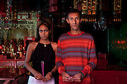 Mauritius. Two young people at a Chinese Pagoda in Port Louis.