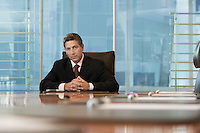 Businessman sitting at conference table portrait