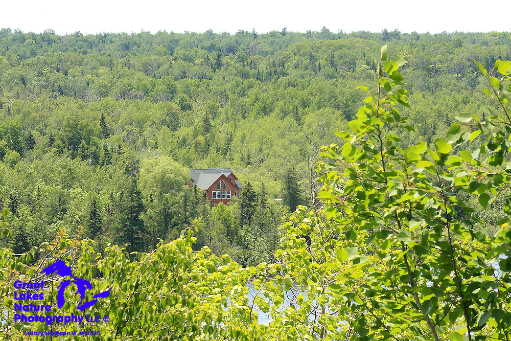 This beautiful residence on the shore of Chain Lake, with its background of dense forest, seems like an ideal retirement location for any nature lover who isn't put off by the Upper Peninsula's challenging winter weather.