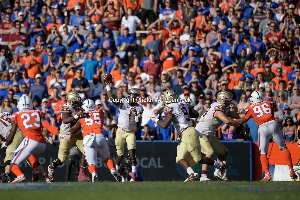 Florida State quarterback James Blackman (1) throws a pass to running back Jacques Patrick (9) during the second half of an NCAA college football game against Florida Saturday, Nov. 25, 2017, in Gainesville, Fla. FSU won 38-22. (Photo by Phelan M. Ebenhack)