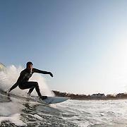 Surfing Monahan's Dock. Swell 12' at 11 secs. Steve Torrissi bottom turn.
