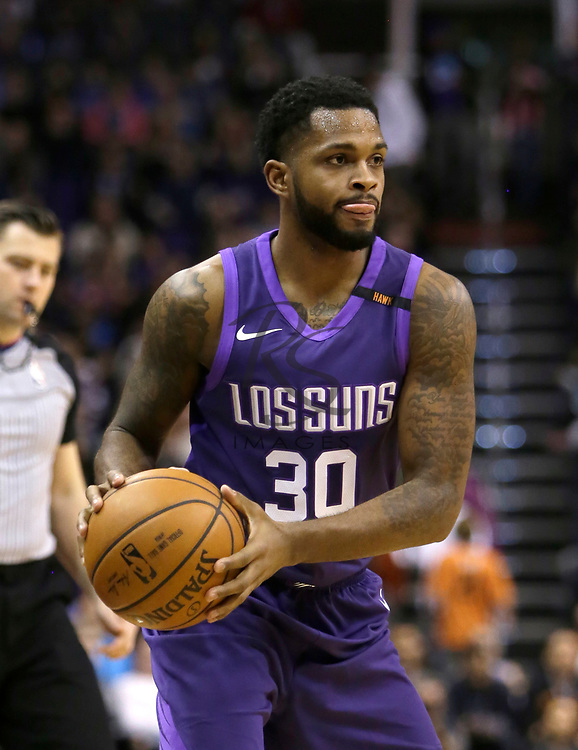 Phoenix Suns guard Troy Daniels (30) in the first half during an NBA basketball game against the New York Knicks, Friday, Jan. 26, 2018, in Phoenix. (AP Photo/Rick Scuteri)