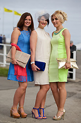 LIVERPOOL, ENGLAND - Friday, April 4, 2014: Sarah Page, Amie Reeves and Emma Cook from Hellsby during Ladies' Day on Day Two of the Aintree Grand National Festival at Aintree Racecourse. (Pic by David Rawcliffe/Propaganda)