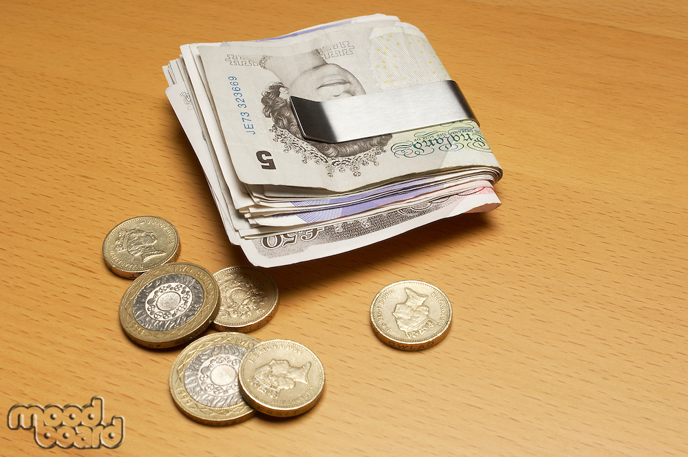Money clip with banknotes and coins