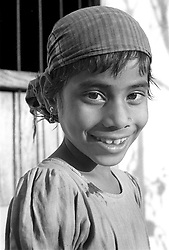 BANGLADESH BOGRA DISTRICT BOGRA DEC94 - A young Muslim girl smiles as she poses for a photograph, the first ever taken of her...The Bangladesh Bureau of Statistics estimates the total working child population between 5 and 17 years old to be at 7.9 million...jre/Photo by Jiri Rezac..© Jiri Rezac 1994