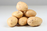 Close up of potatoes on white backround
