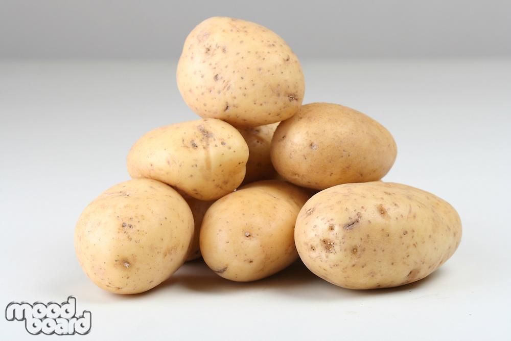 Close up of potatoes on white backround