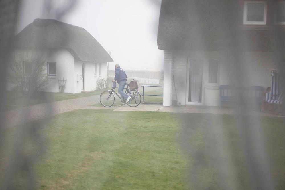 Amrum | Germany | 04 17 2011 : The Boyens' family, living on the German North Sea Island of Amrum is making their living bei renting roofed wicker beach chair (Strandk&ouml;rbe). Strandk&ouml;rbe are a quite unique German invention.<br /> <br /> here: <br /> <br /> ________________<br /> <br /> Amrum | Deutschland | 17.04.2011 : Die Familie Boyens betreibt seit mehr als 55 Jahren einen Strandkorbverleih am Strand von Norddorf.<br /> <br /> hier:  Pimo Boyens bricht mit dem Rad zur Fr&uuml;hschicht am Strand auf.<br /> <br /> Sascha Rheker<br /> 20110417<br /> <br /> <br /> [Inhaltsveraendernde Manipulation des Fotos nur nach ausdruecklicher Genehmigung des Fotografen. Vereinbarungen ueber Abtretung von Persoenlichkeitsrechten/Model Release der abgebildeten Person/Personen liegt/liegen nicht vor.]
