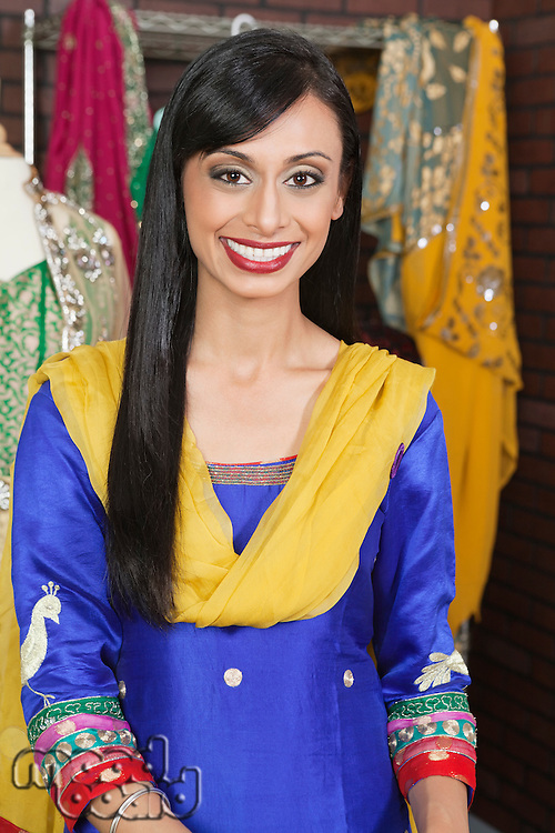 Portrait of an attractive Indian female dressmaker smiling