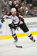DALLAS, TX - SEPTEMBER 26:  Erik Johnson #6 of the Colorado Avalanche controls the puck against the Dallas Stars in an NHL preseason game on September 26, 2013 at the American Airlines Center in Dallas, Texas.  (Photo by Cooper Neill/Getty Images) *** Local Caption *** Erik Johnson