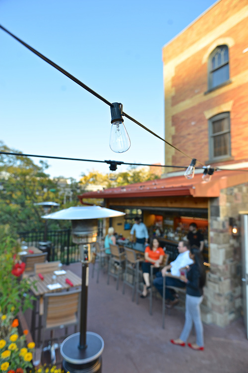 Outdoor lighting over the outdoor bar at Nuevo Modern Mexican & Tequila Bar.