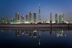 The Burj Dubai and buildings under construction reflected in Business Bay, Dubai