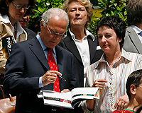 Photo: Glyn Thomas.<br />Portugal v Iran. Group D, FIFA World Cup 2006. 17/06/2006.<br /> Franz Beckenbauer (L) signs an autograph for the German Justice Minister (Bundesministerin der Justitz) Brigitte Zypries who are both in Frankfurt to watch the match between Portugal and Iran.